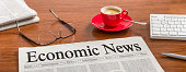 Newspaper on a wooden desk - Economic News