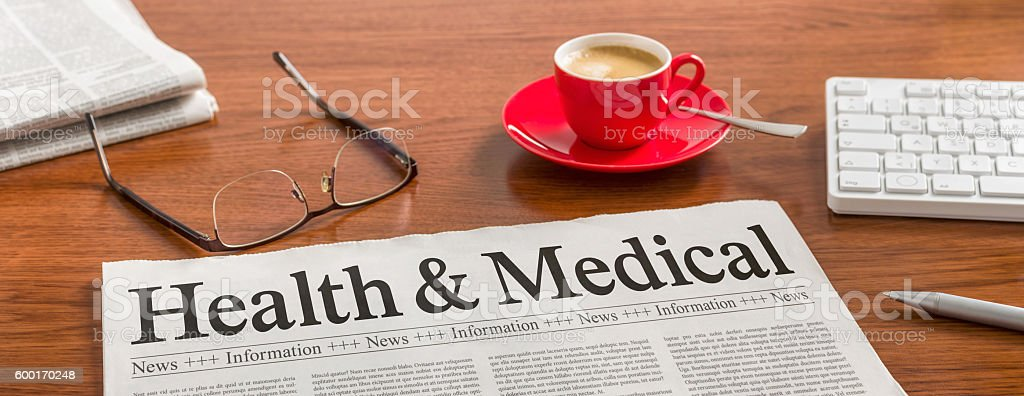 Newspaper on a wooden desk - Health and Medical stock photo