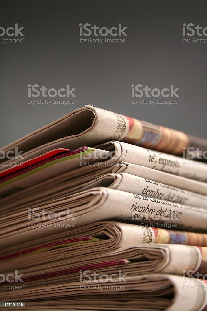 Newspaper on black  background royalty-free stock photo
