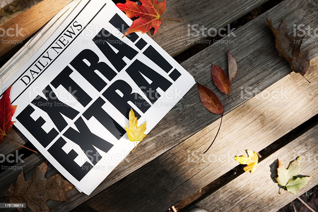EXTRA! Newspaper on Wooden Steps with Autumn Leaves royalty-free stock photo