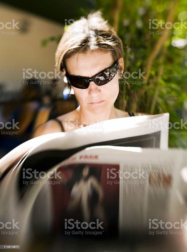 Newspaper reader stock photo