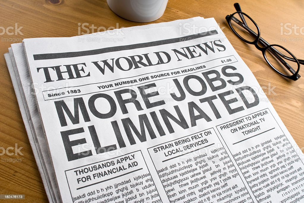 Newspaper showcasing unemployment headlines royalty-free stock photo