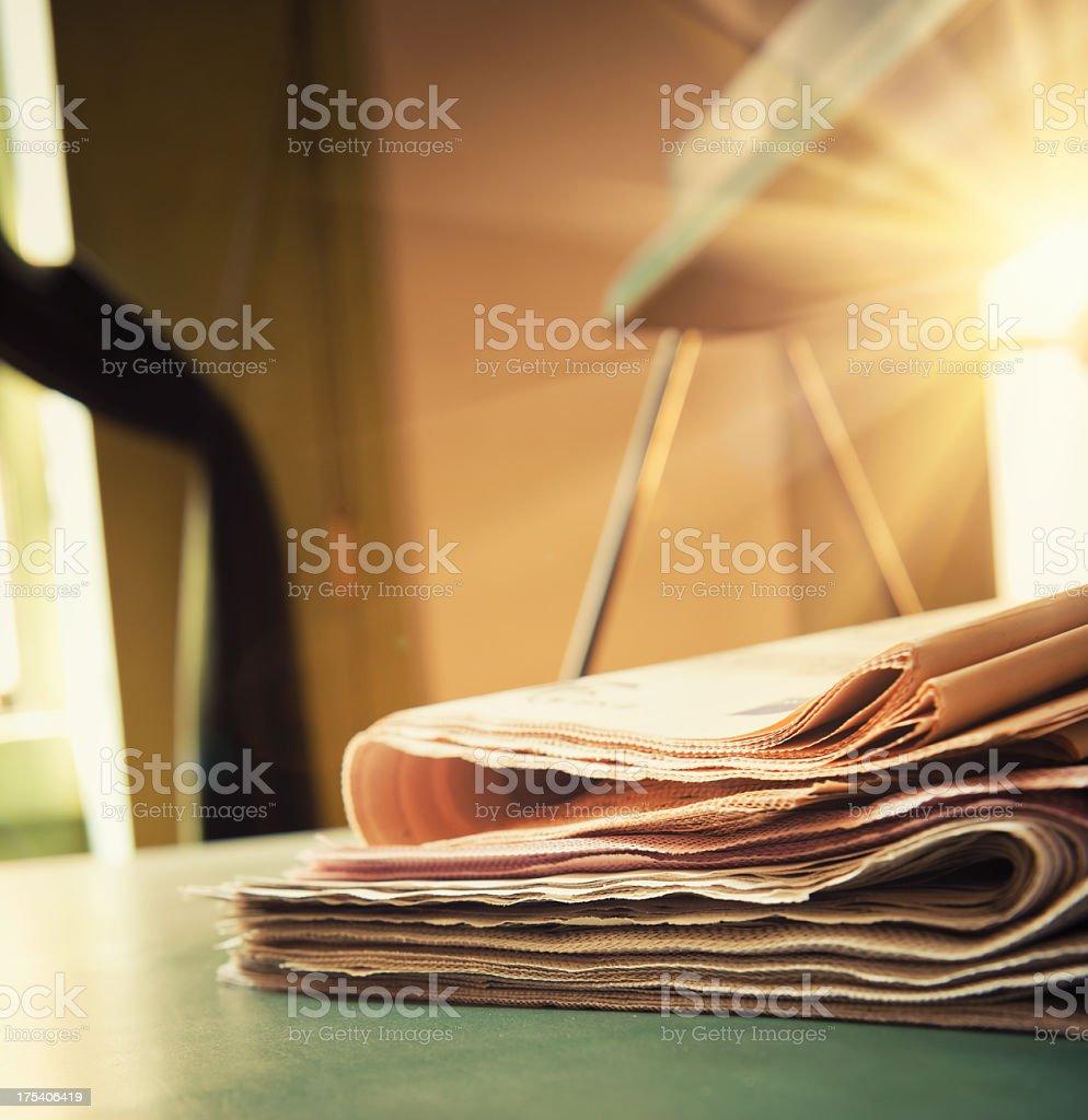 Newspaper stack close up stock photo