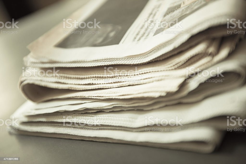 Newspaper stack close up royalty-free stock photo