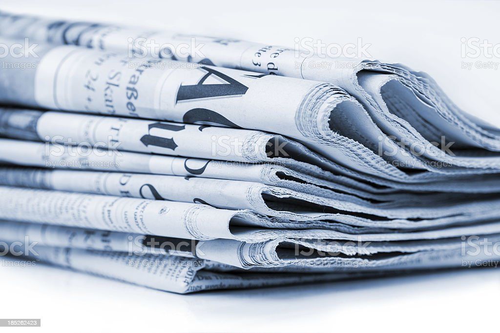 Newspaper stack (blue toned) royalty-free stock photo