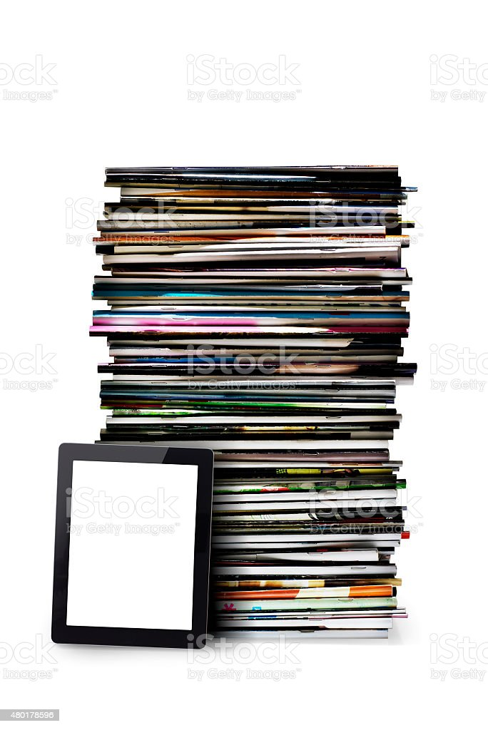 Newspaper stack with tablet stock photo