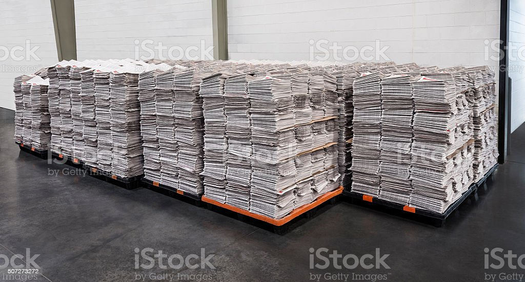 Newspaper Stacks on Pallets stock photo