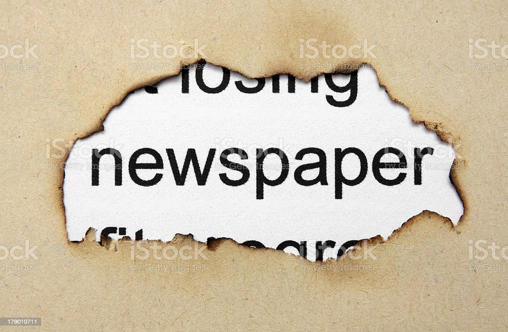Newspaper text on paper hole royalty-free stock photo