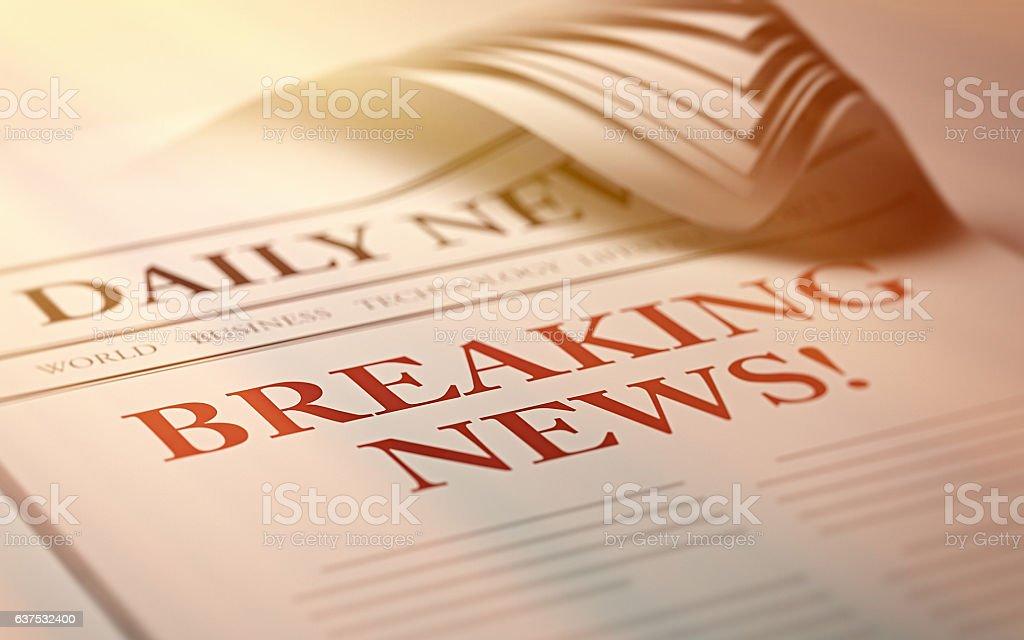 Newspaper with Breaking News Headline stock photo