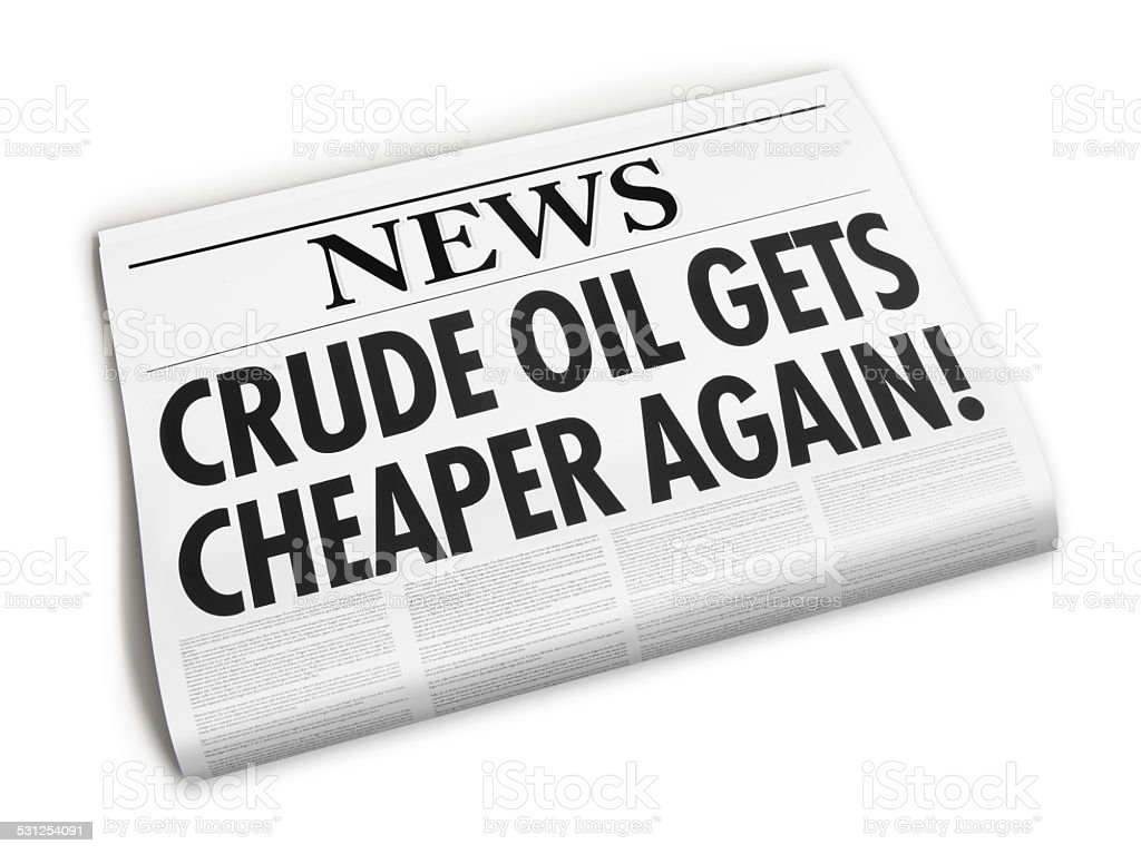 Newspaper with Crude oil gets cheaper headline stock photo