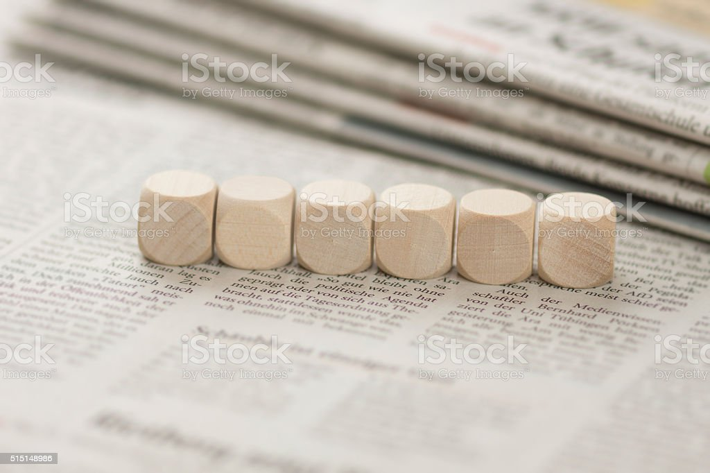 Newspaper with cubes stock photo