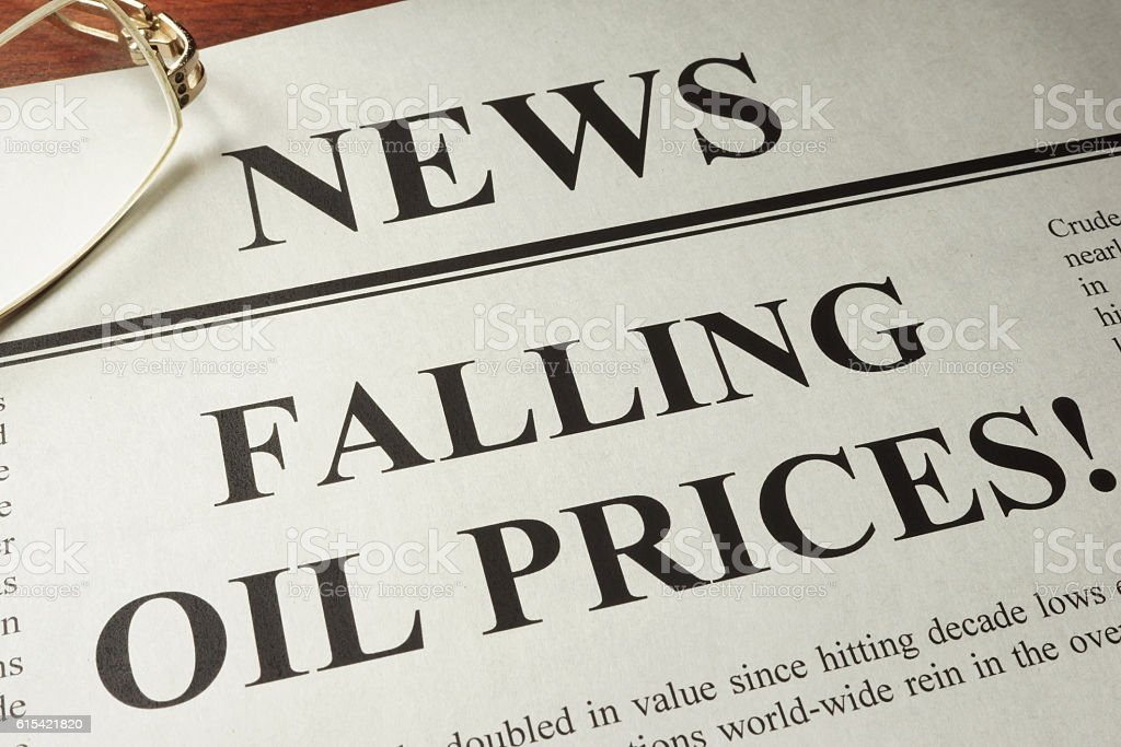 Newspaper with header news and Falling oil prices. stock photo