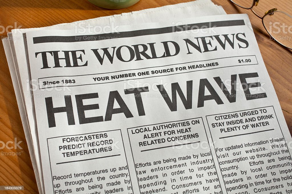 A newspaper with heat wave headlines in bold stock photo
