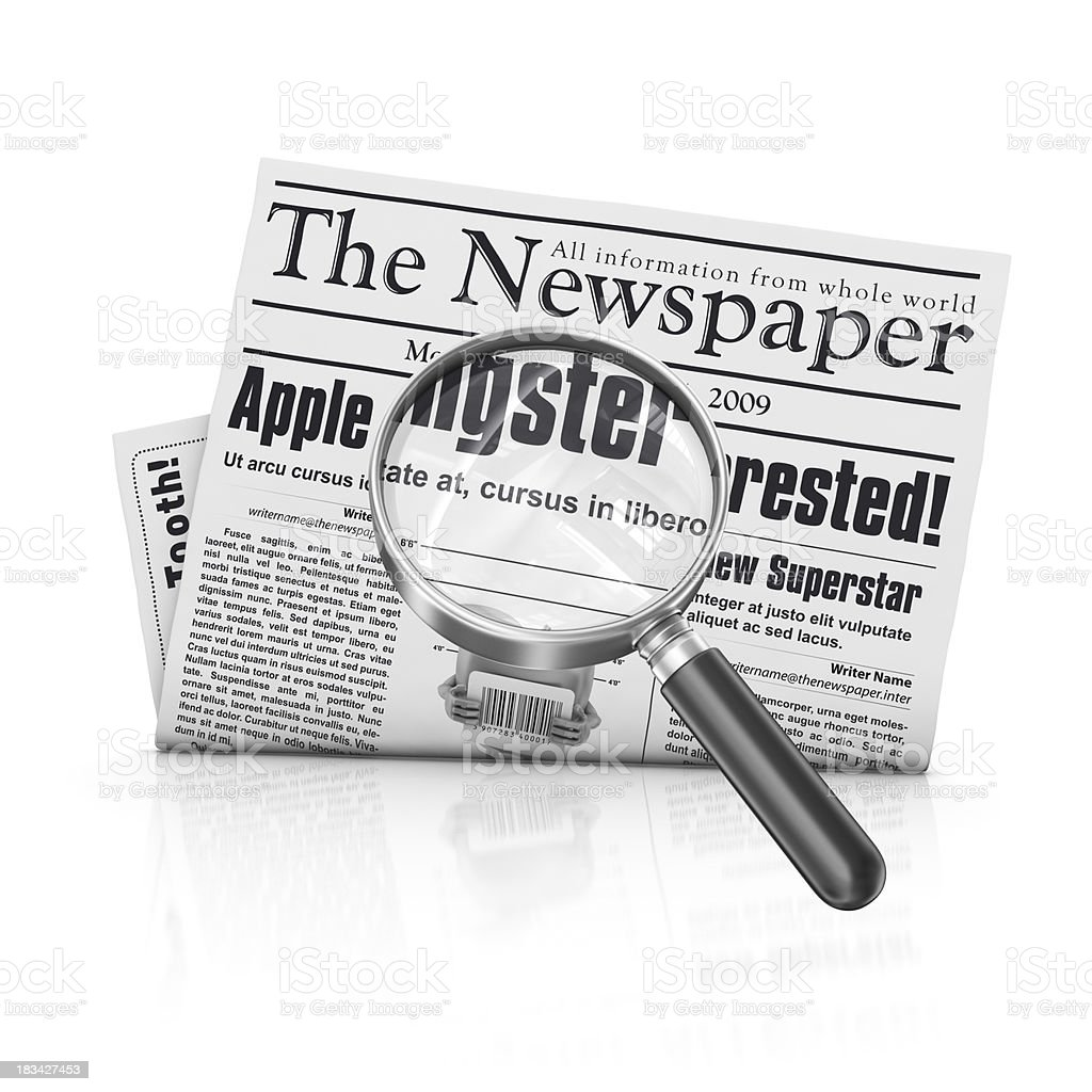 newspaper with loupe stock photo