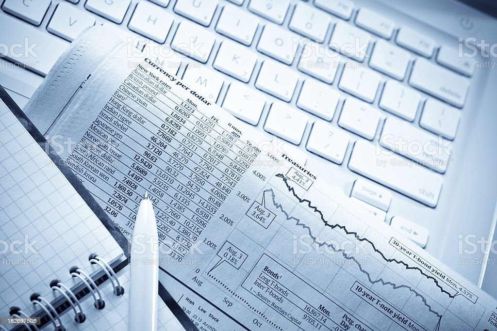 Newspaper with notepad and pen on laptop royalty-free stock photo
