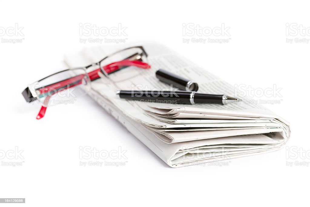 newspaper with pen and glasses royalty-free stock photo