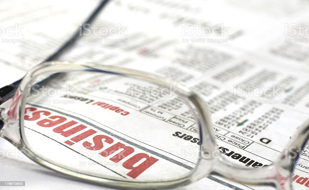 Newspaper with spectacles stock photo