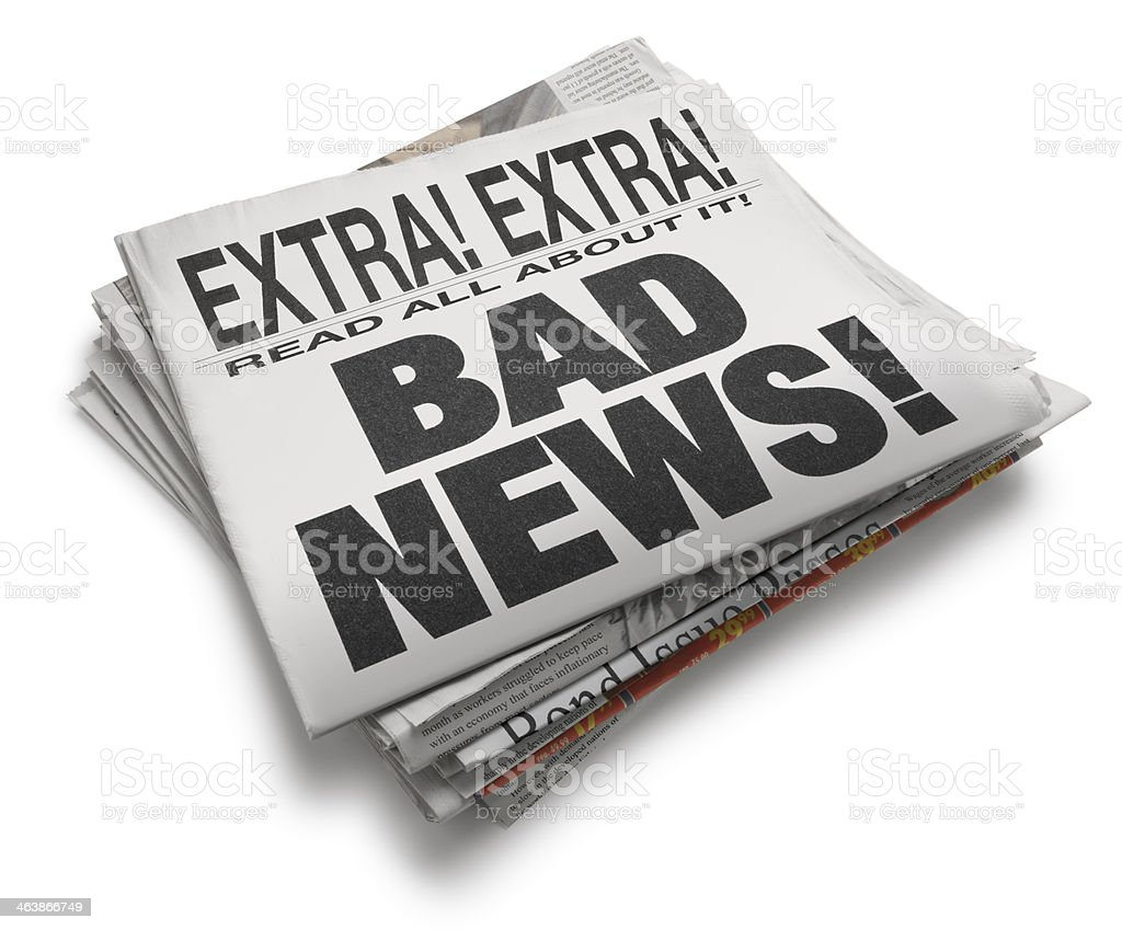 Newspaper with the headline 'Bad News!' isolated on white background royalty-free stock photo