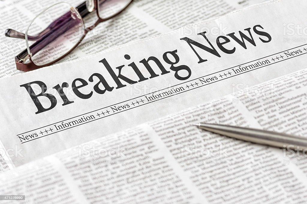 Newspaper with the headline Breaking News stock photo