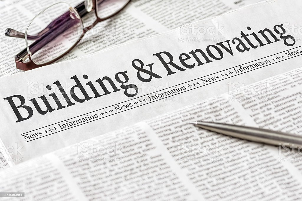 Newspaper with the headline Building and Renovating stock photo