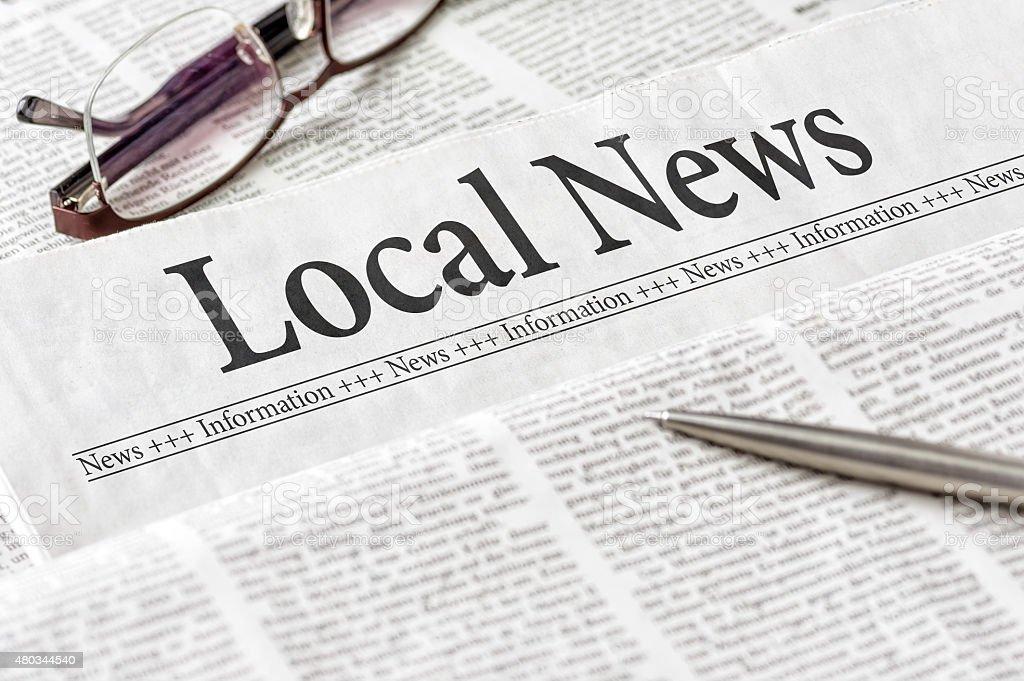 Newspaper with the headline Local News stock photo