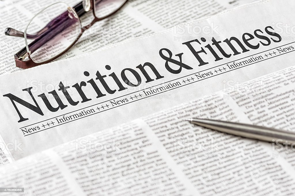 Newspaper with the headline Nutrition and Ftitness stock photo