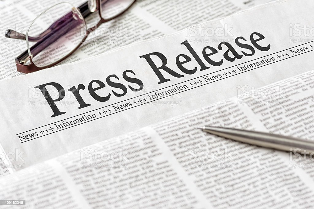 Newspaper with the headline Press Release stock photo