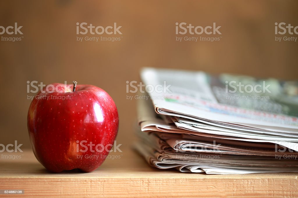 Newspapers and apple stock photo