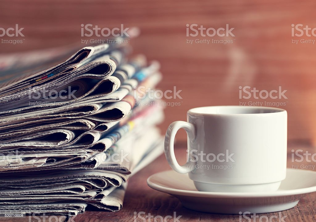 Newspapers and Coffee stock photo