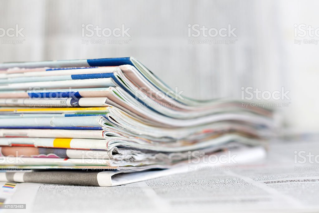 Newspapers and magazines background concept stock photo