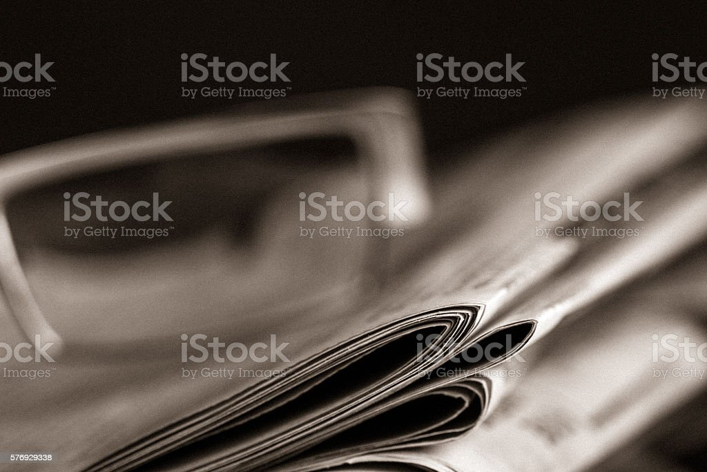 Newspapers and reading glasses stock photo