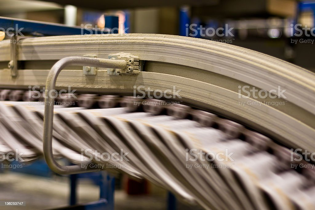 Newspapers in a gripper chain stock photo