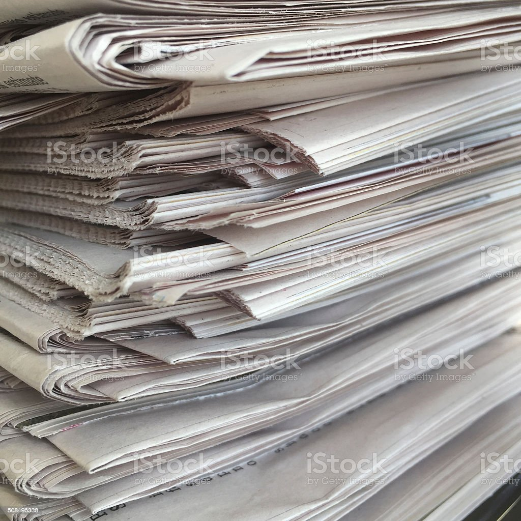 Newspapers in a Stack stock photo