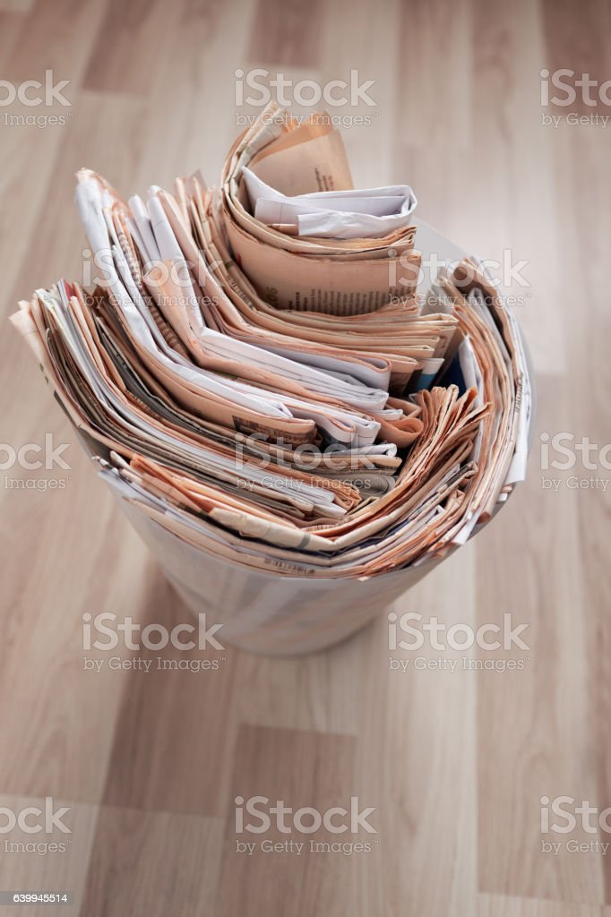 Newspapers in the recycle bin stock photo