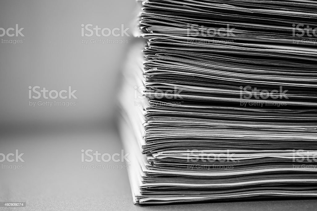Newspapers stacked one on the other stock photo