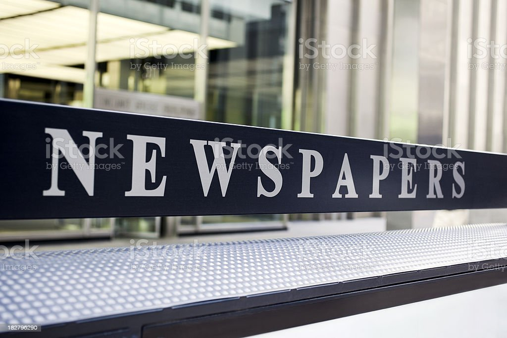 Newspapers Stand Sign royalty-free stock photo