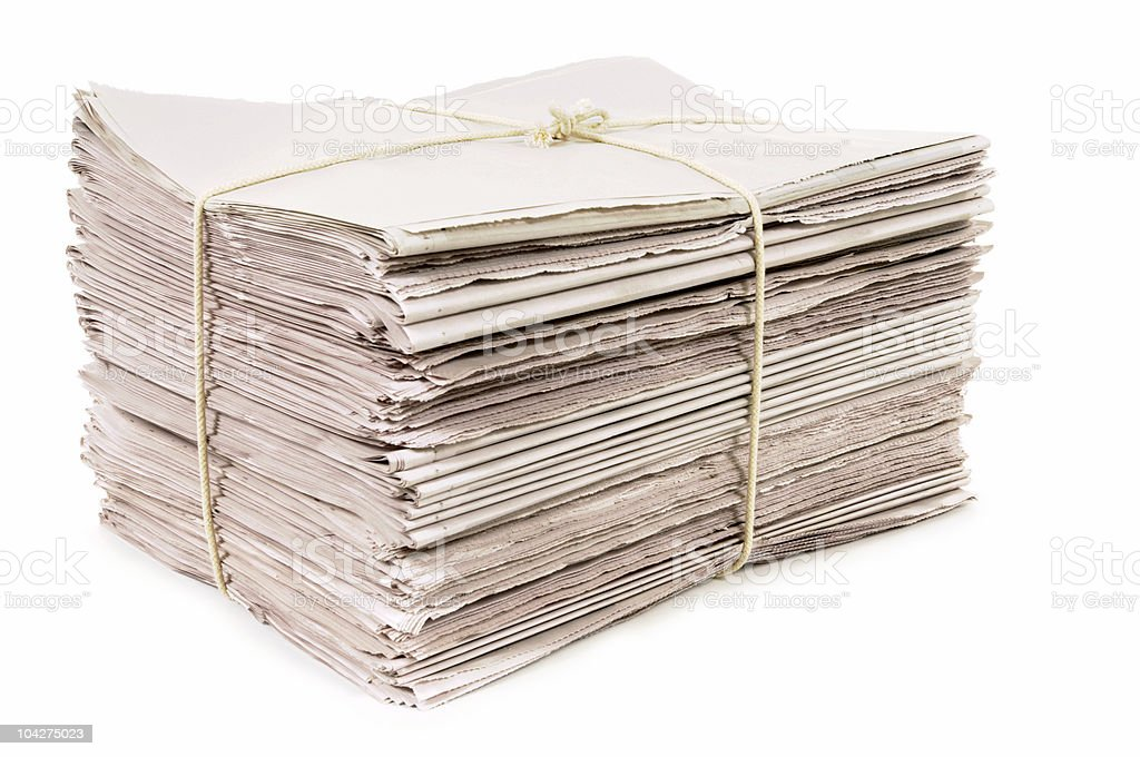 Newspapers tied with rope royalty-free stock photo