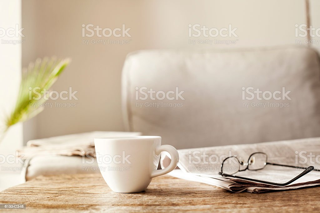 Newspapers with eyeglasses and coffee stock photo