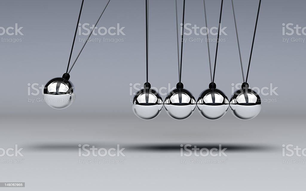 Newtons Cradle in motion stock photo