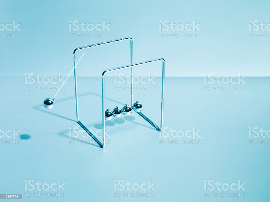 Newton's cradle swinging stock photo