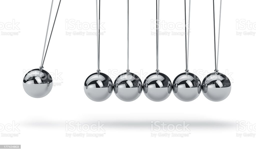 Newtons cradle with metal balls hanging in a line stock photo