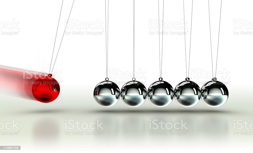 Newton's Cradle with red ball stock photo