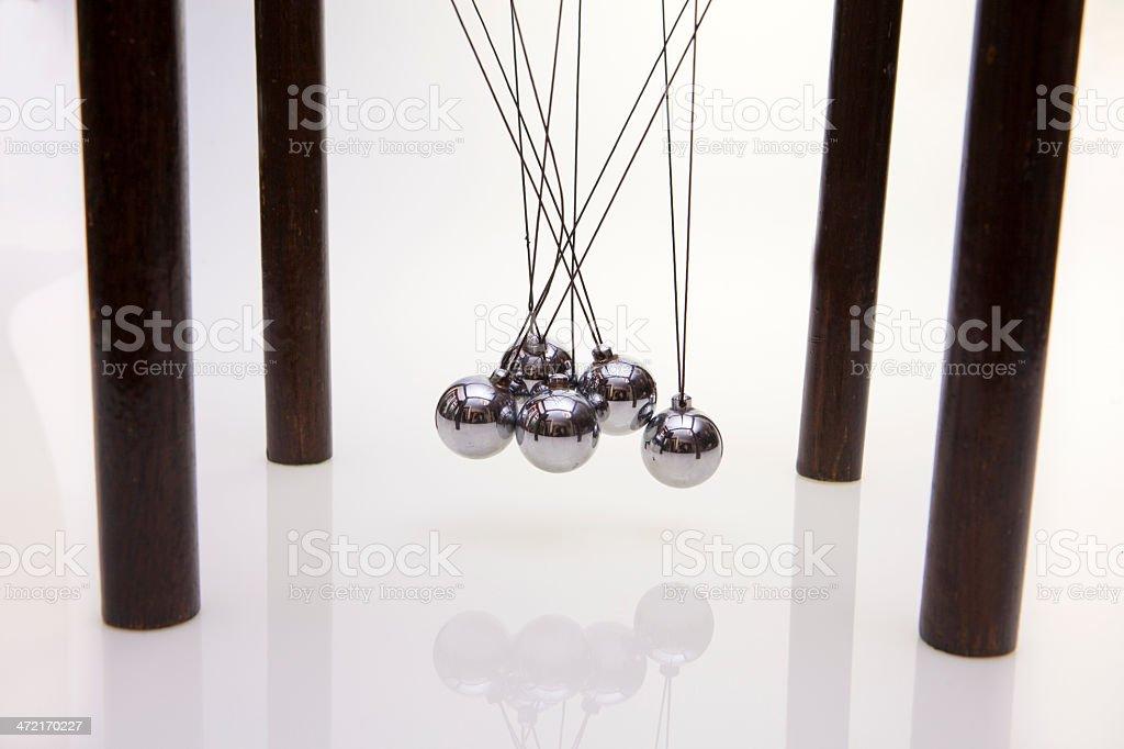 Newton's pendulum - a tangled issue stock photo