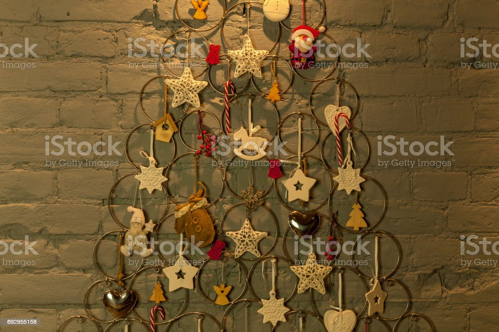 new-year tree from metallic rings and toys stock photo