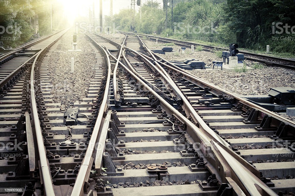A nexus of converging railroad track points stock photo