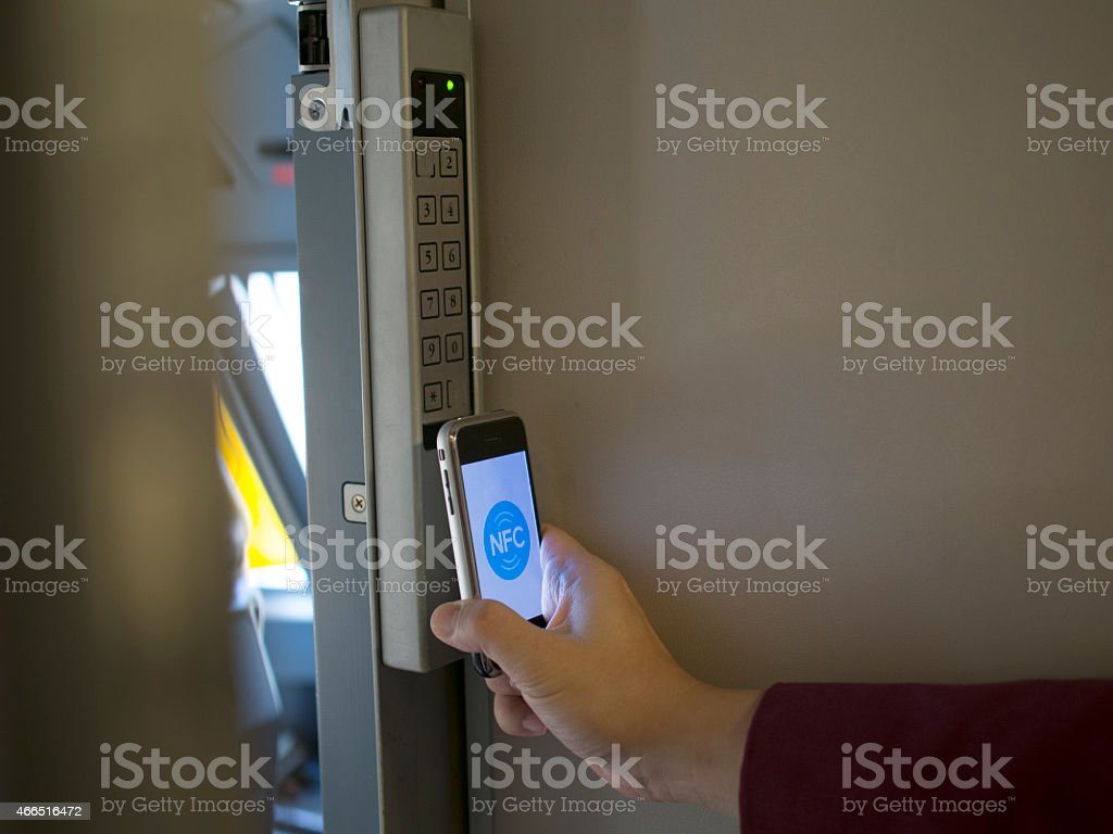 nfc's mobile phone use for open safety door (horizontal picture) stock photo