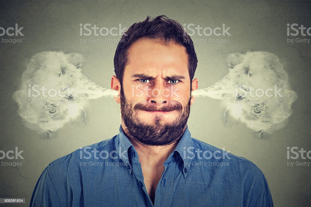 ngry young man, blowing steam coming out of ears stock photo