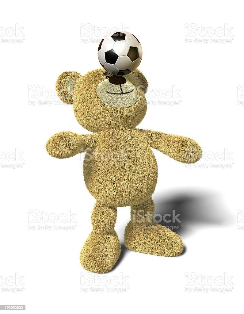 Nhi Bear balances soccer ball on nose, front royalty-free stock photo