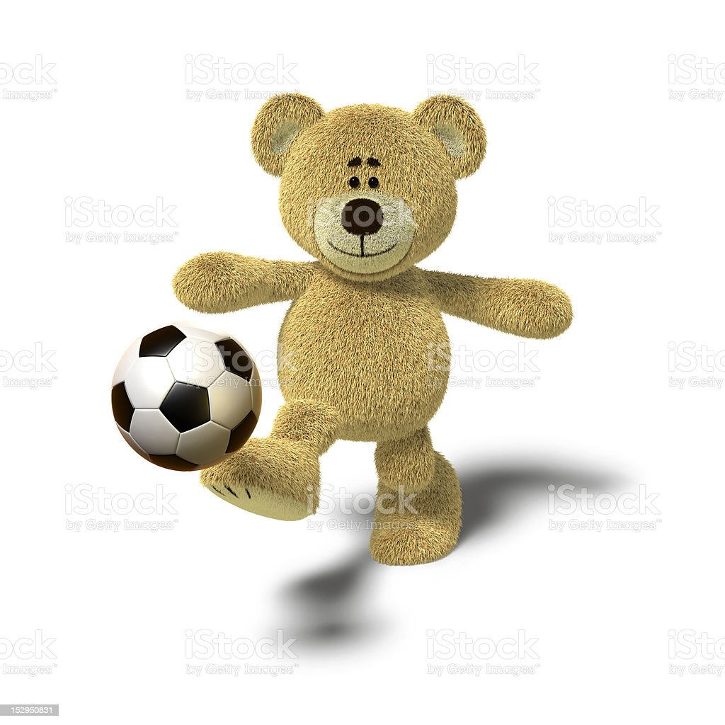 Nhi Bear kicking a soccer ball, Front royalty-free stock photo