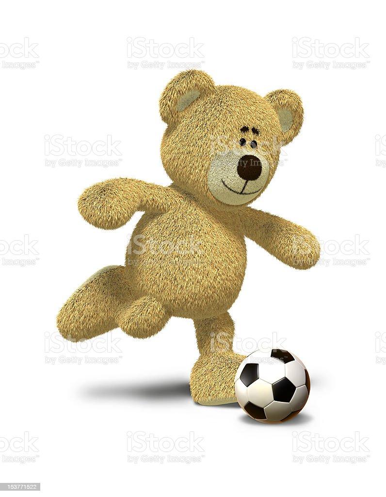 Nhi Bear kicks a soccer ball stock photo
